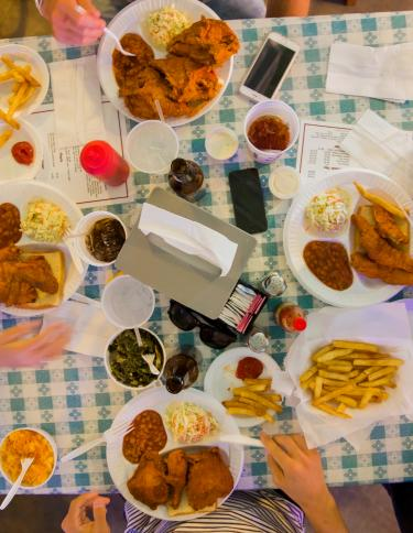Four friends dine-in at Gus's Fried Chicken