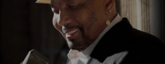 Aaron Neville smiling with microphone