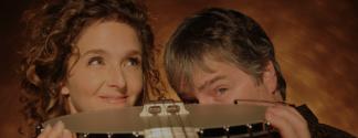 Bela and Abigail holding a banjo