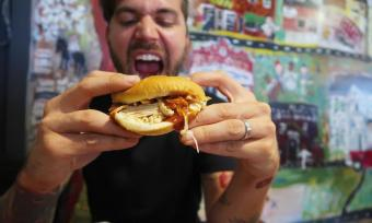 man eating BBQ Sandwich